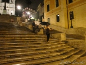 running-down-spanish-steps-in-rome